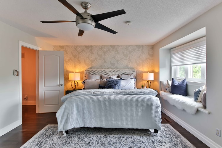 Bedroom with White Ceiling Fan