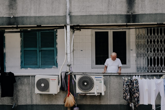 Man Looking Down at Air Conditioner