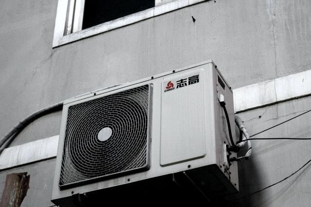 White & Gray Wall with Air Conditioner Condenser