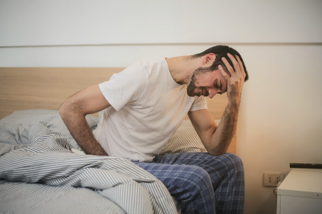 Young Man Suffering from Headache in Morning